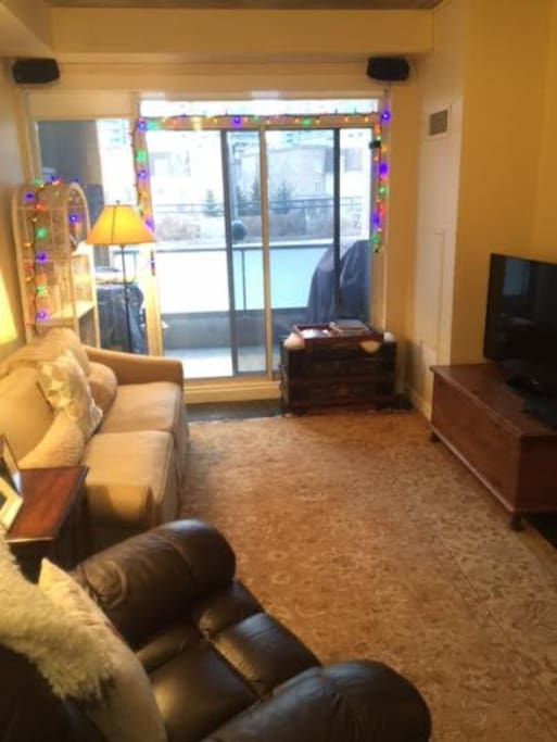 Very livable family room - with access to private BBQ on balcony