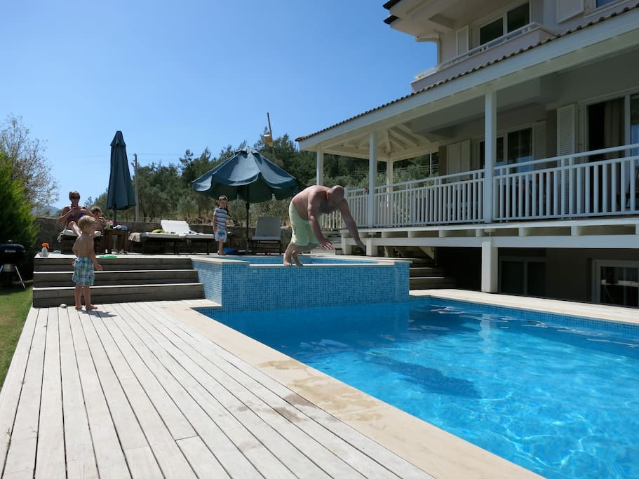 Decking around the pool and private Garden