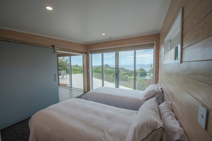 Bedroom with 2 single king beds