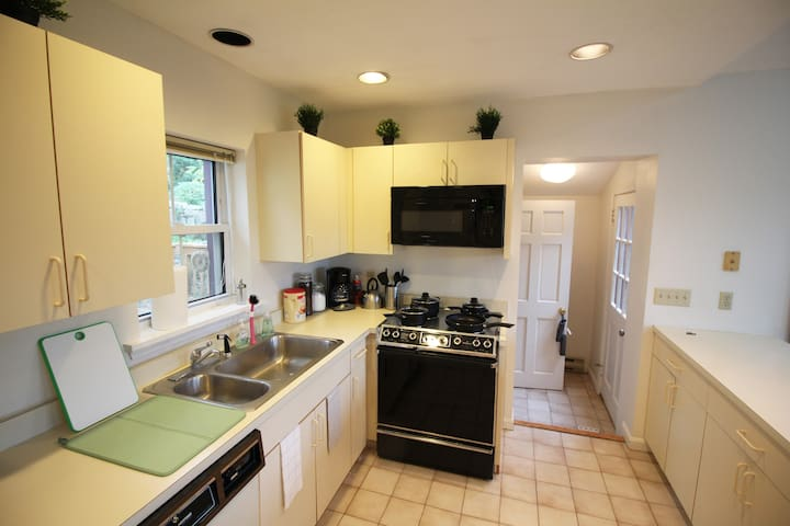 A large kitchen to hang with friends and family