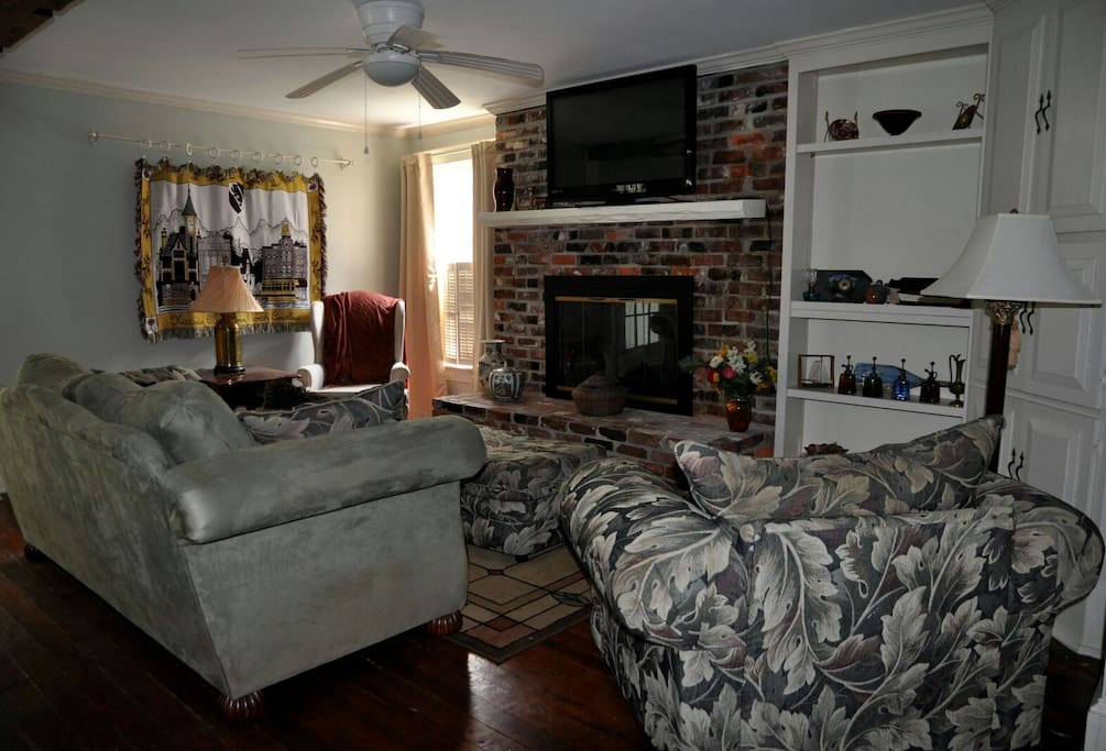 watch your favorite sports in this open living room and great room connected to the kitchen.