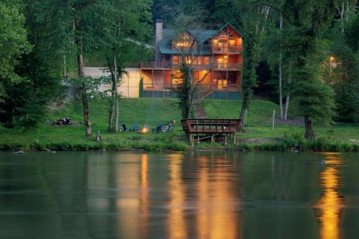 Hunter's Lodge is a luxury water front cabin with hot tub, basketball court and dock