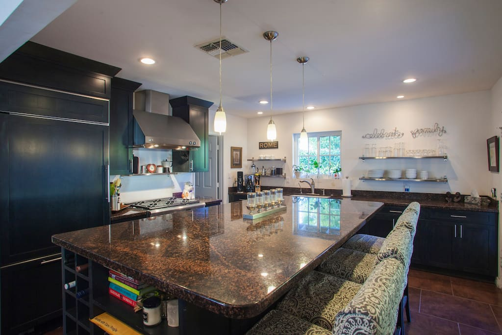Gourmet kitchen with large granite island