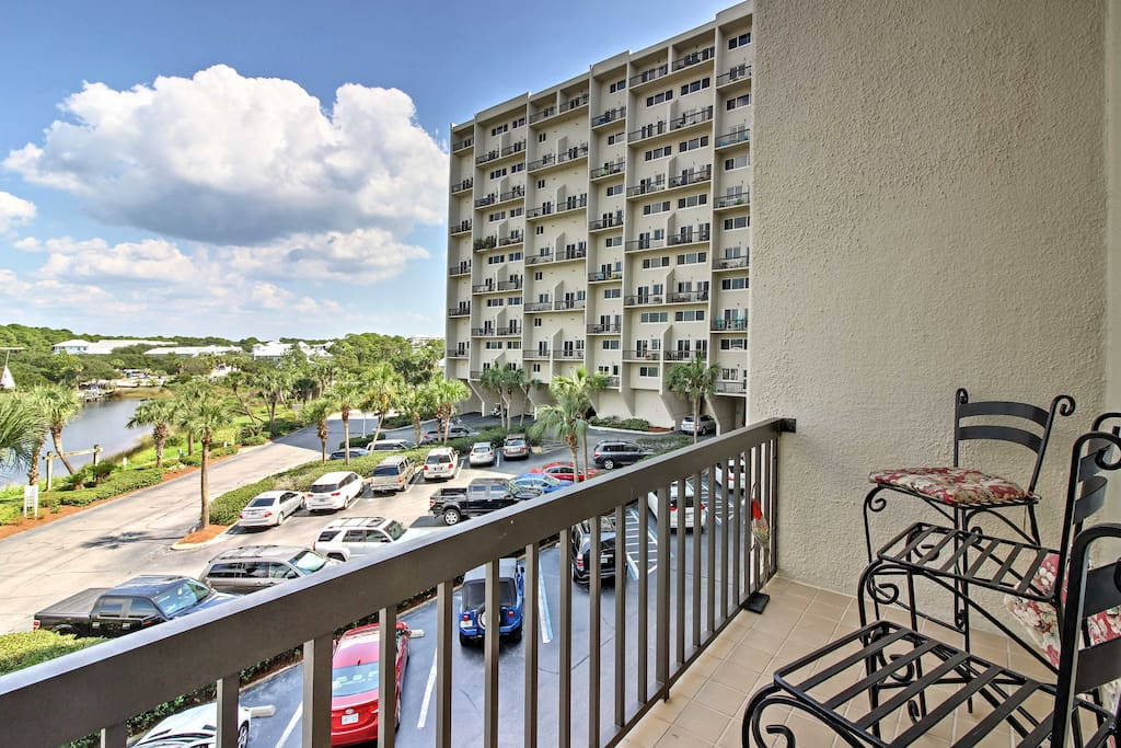 The condo features 2 furnished balconies with lake and ocean views.