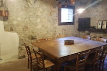 Large table in the 16th century barbecue room at your free disposal