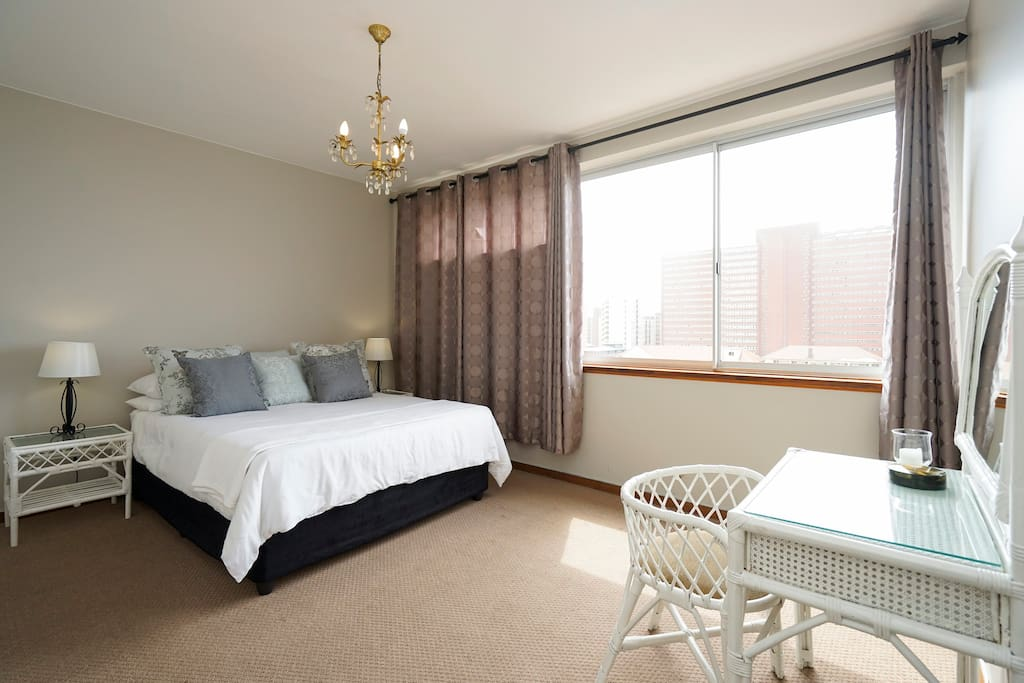 Spacious Main bedroom with small dressing table