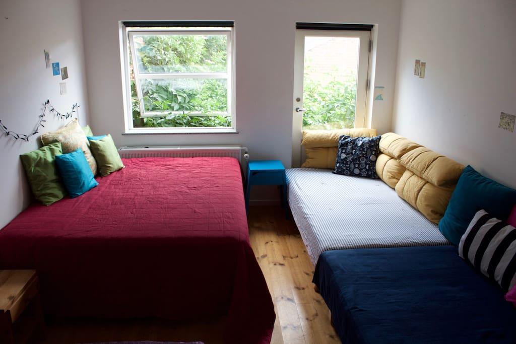 The two beds on the right are actually small doubles (also called three-quarter beds), not singles.
