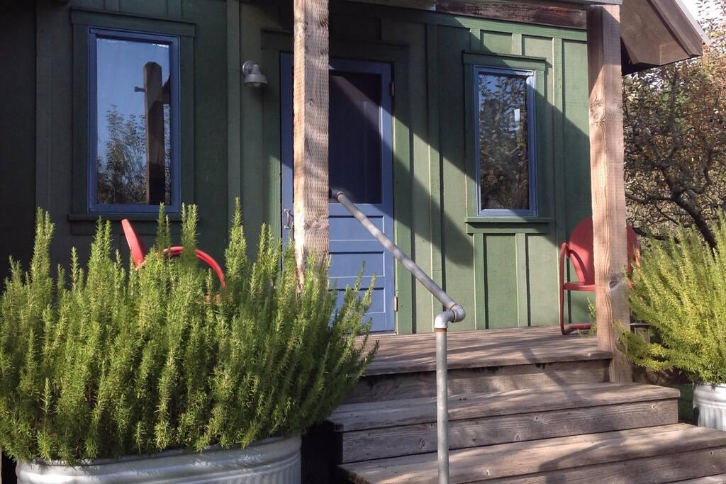 Blue door porch - 4 steps up.