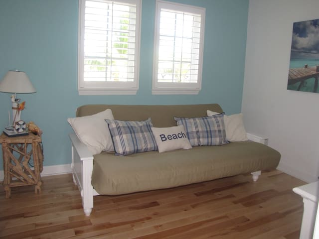 Den with TV bed and full bath