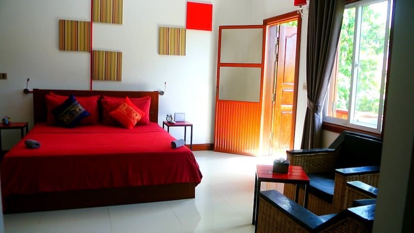 Queen size bed and exit to balcony