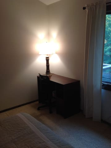 Desk with drawers, office chair with lamp