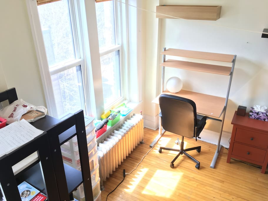 Bright windows, 2 desks (one shown)