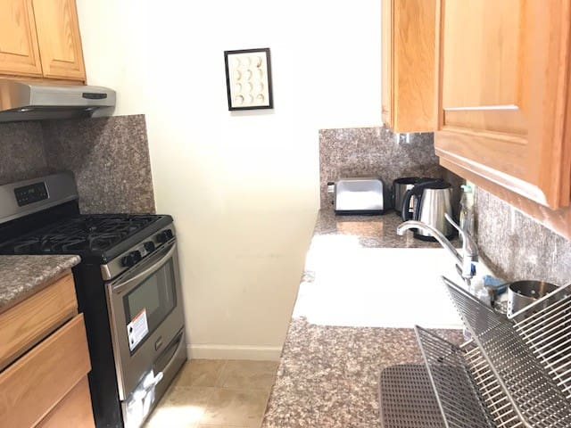 Fully-equipped kitchen with granite counter tops and upgraded oven/stove
