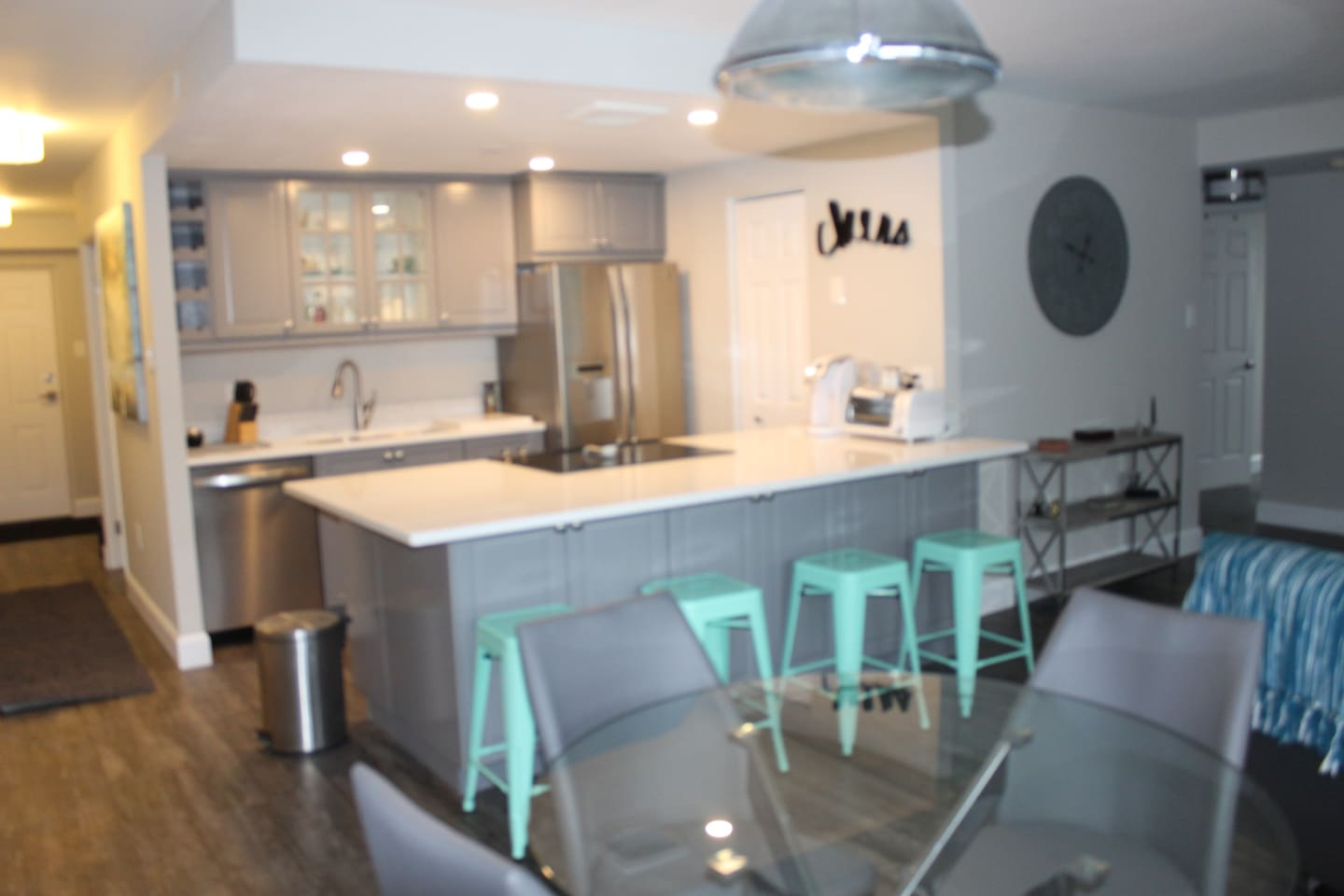 Open concept luxury kitchen, equipped with full size built in appliances and ample prep space with over sized quartz counters and bar area.