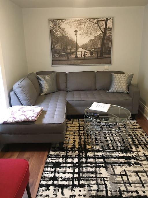 Family room with sectional and chair