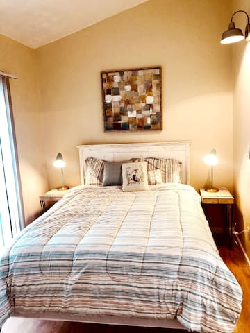 Queen size bed in this cute and cozy bedroom