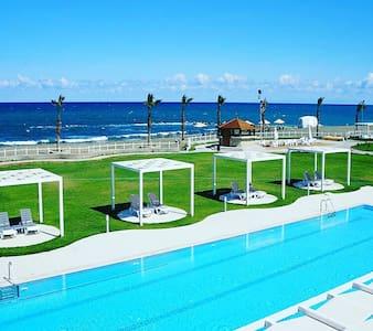 Sea view new apartment in Aphrodite beach resort