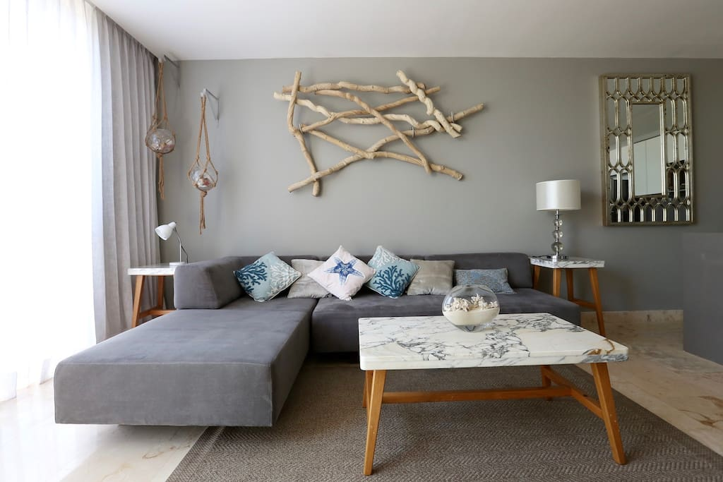 LIVING ROOM, with a comfortable sectional sofa bed.