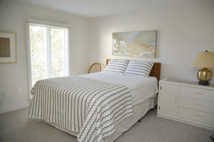 Queen bed in second upstairs bedroom.