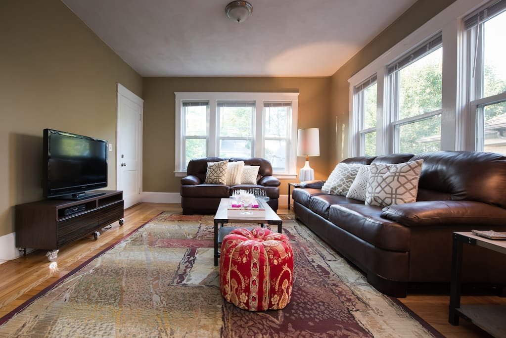 Living room is simple and uncluttered and stays cozy.
