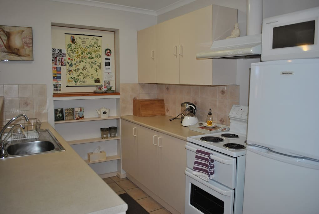 The compact kitchen area is ideal for making that morning coffee, plus well stocked cupboards for preparing gourmet meals.