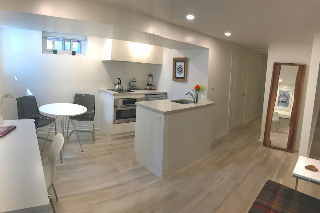 The full kitchen has a deep stainless sink and high efficiency appliances – fridge, stovetop, microwave and oven. Nearby, you'll love our tall, wood-crafted standing mirror.