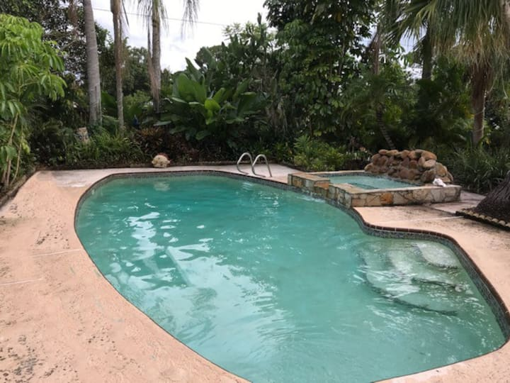 Coquina   -pool -tropical landscaping-heated spa .