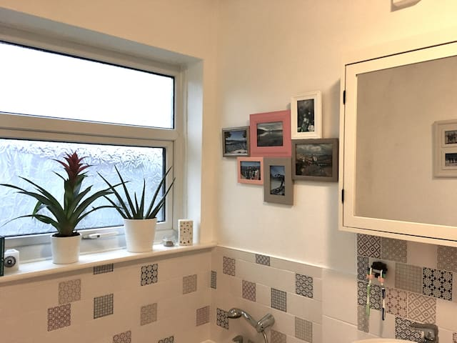 Recently refitted bathroom with walk-in shower and full size bath