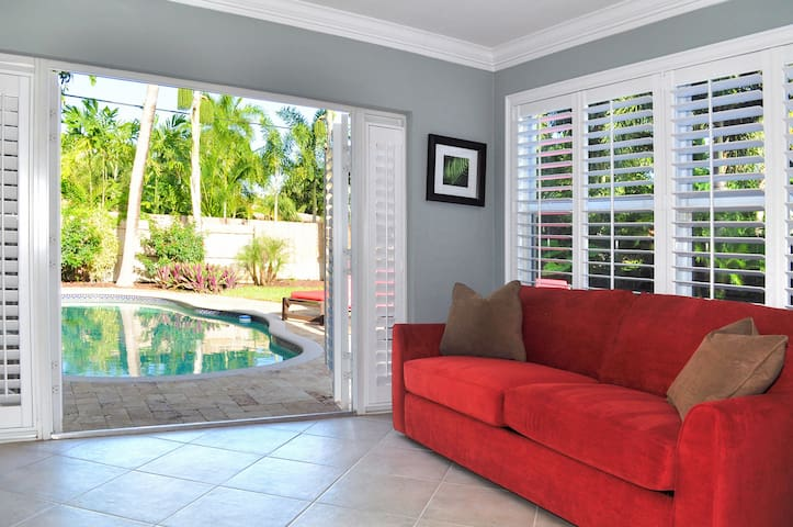 Has french doors leading to the pool/patio area, flat screen TV and next to laundry room.