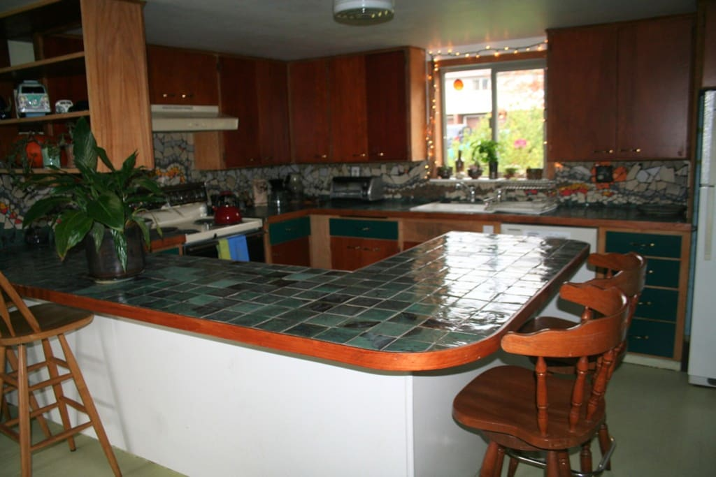 Here is our kitchen. Lots of counter space and cabinets. Our handmade tiles and decorative backsplash get lots of complements. Fortified with lots of handmade pottery.