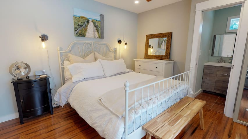 Master Bedroom with Queen bed and half-bath.  Room has a slider that goes onto private deck.  Mini-split heater/a/c in this room with a ceiling fan.  Linens provided for all beds.