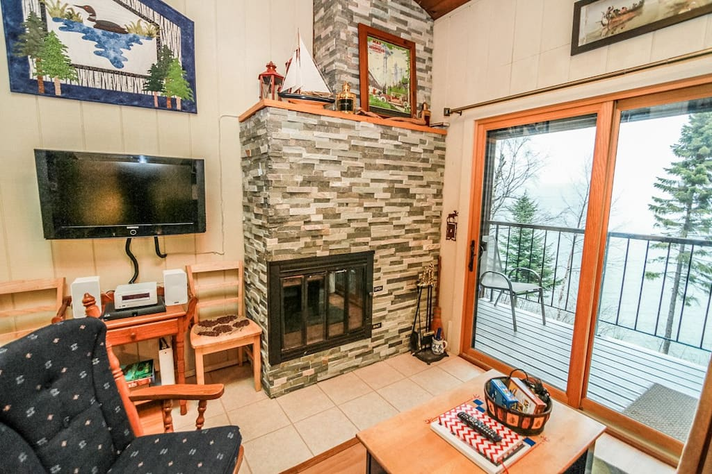 The wood burning stone surround fireplace is great for cold winter nights.