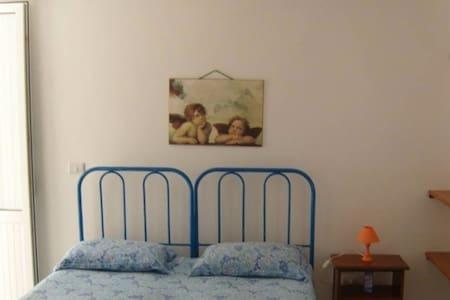 Camera doppia in appartamento fronte mare - Capilungo