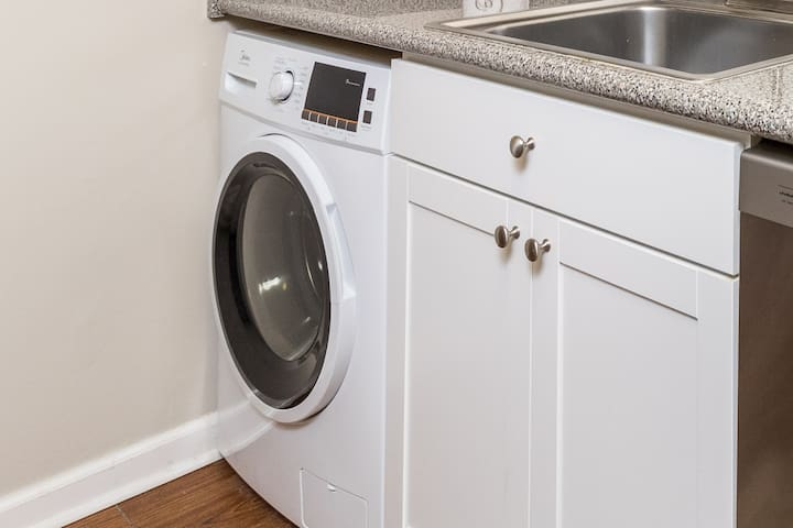 Combination washer/dryer unit.  It both washes and drys launder in one 3 hour cycle.  Put laundry in before you leave for work and come home to a completed load of laundry.
