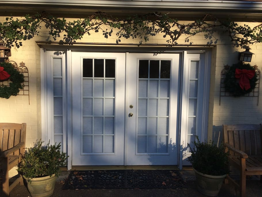 Carriage House downstairs studio entrance.  Center french door entrance.
