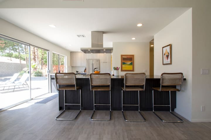 Mammoth island with counter stools that open to living room