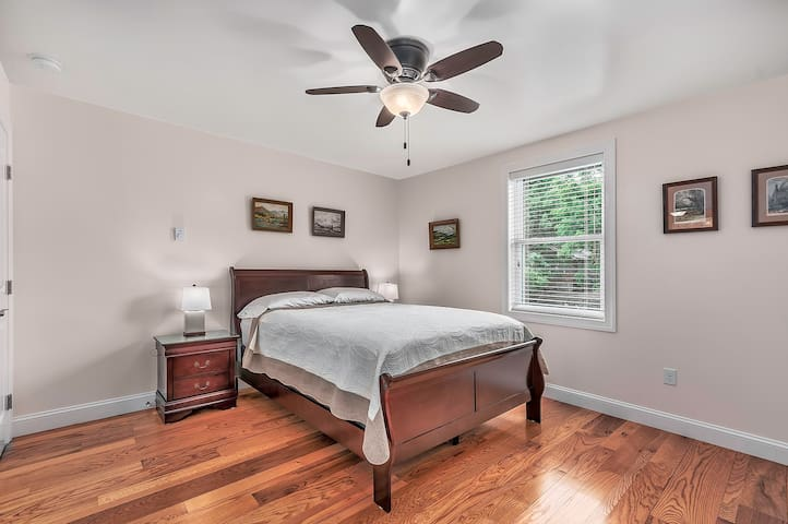 """""""Tree"""" bedroom, with queen-sized bed. Bedrooms include ample, full dressers and closets."""