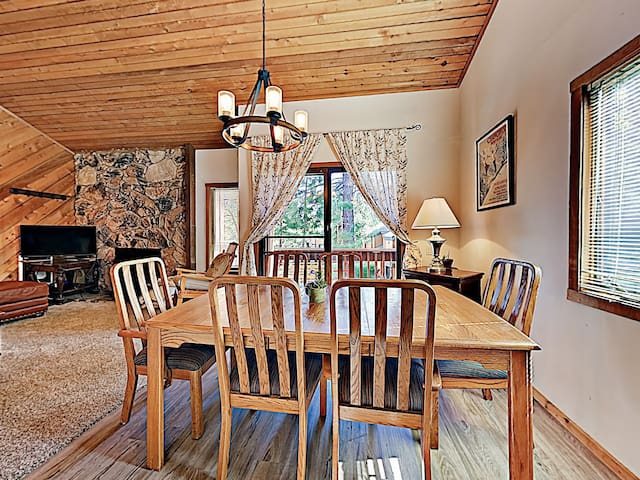 Enjoy vacation meals around the wooden dining table.
