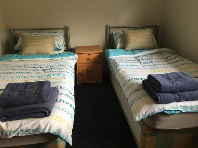 3rd Bedroom, twin singles. Sky Q TV, views over patio/garden
