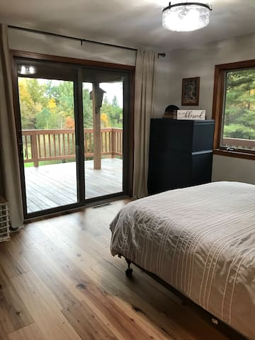 A view out the patio doors plus a large window!  A retreat room in itself.  Large closet area as well