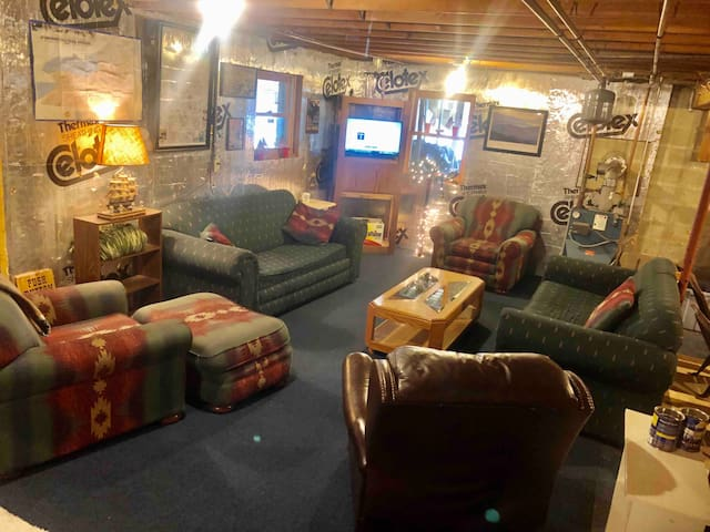 """Listed as a bedroom Bc Airbnb doesn't show bonus/basement.  Furnished basement is perfect  hangout after snowmobiling or day at lake. 2 couches (one is a sleeper/pull out), chairs, wine rack, 32"""" TV and Queen elevated Air-Bed."""