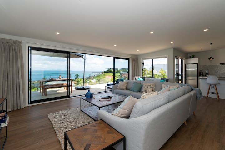 Open plan living area opens out onto the sundeck and views