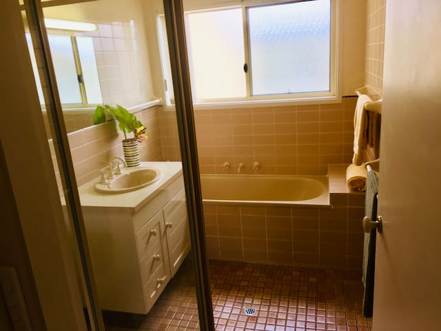 Full bathroom on 1st floor with separate bath and shower. Another separate WC is also on this floor