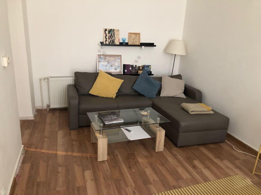 sofa in the living room which is in the rear corner and not visible on the main photo