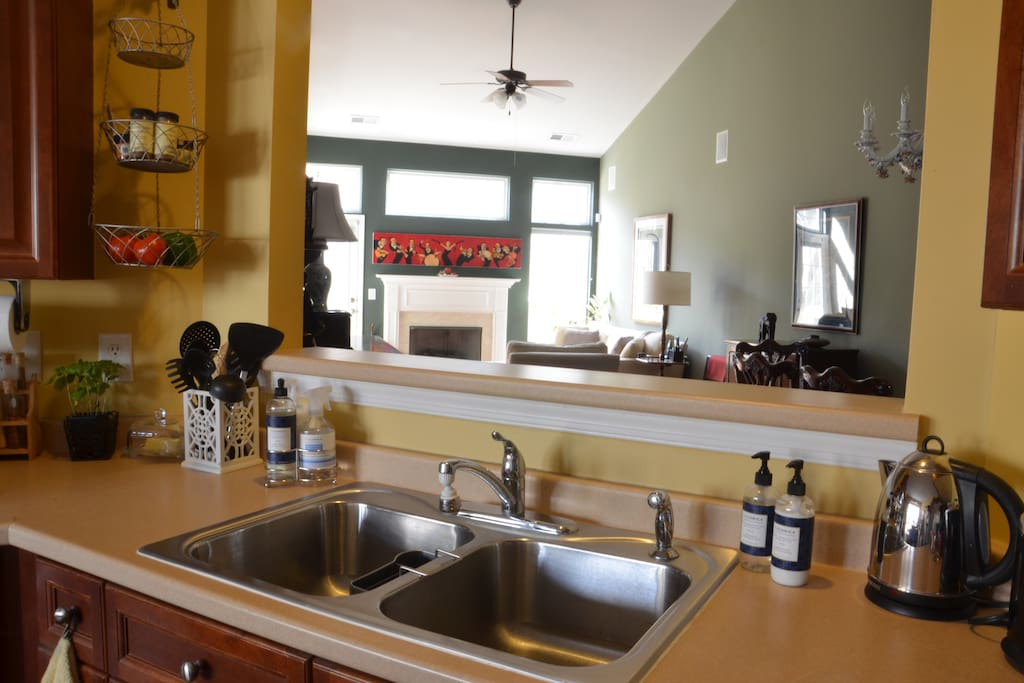 Plenty of sink & counter space overlooking dining & living areas