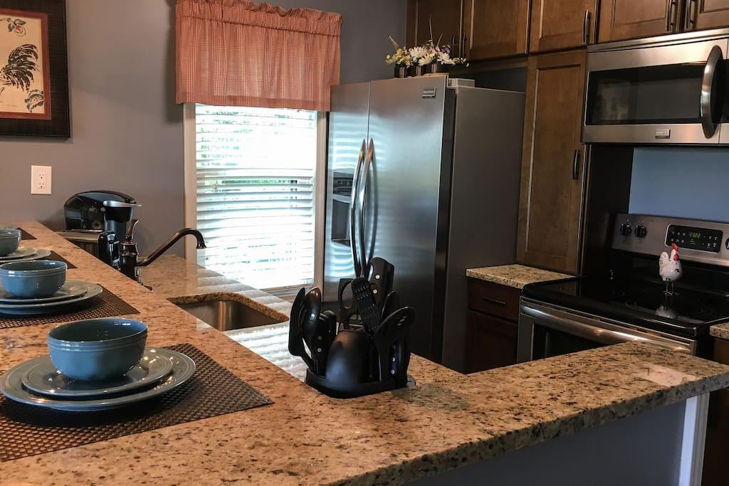 New Gallery stainless steel appliances and granite countertops