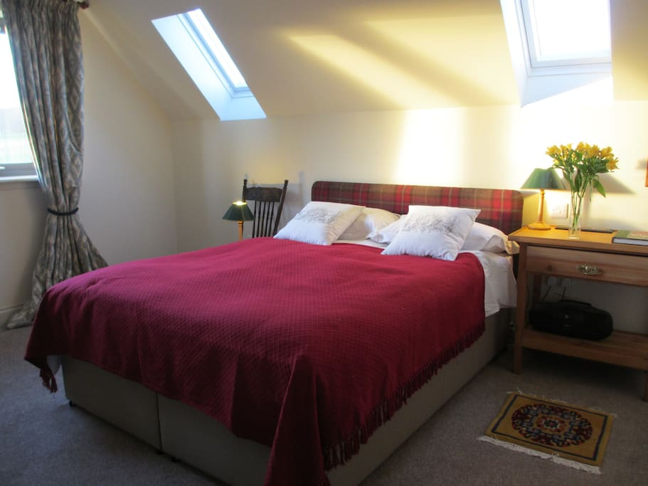 Double bedroom ensuite with additional single bed and west facing hill views
