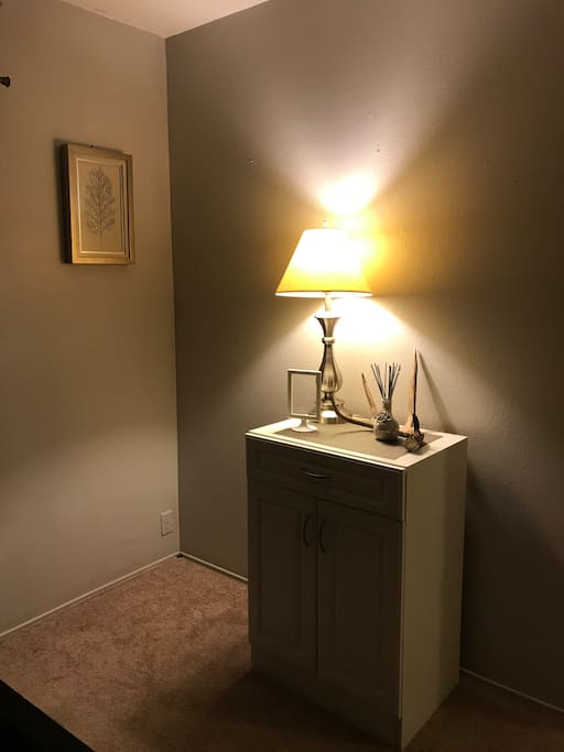 Small storage dresser, lamp and decor