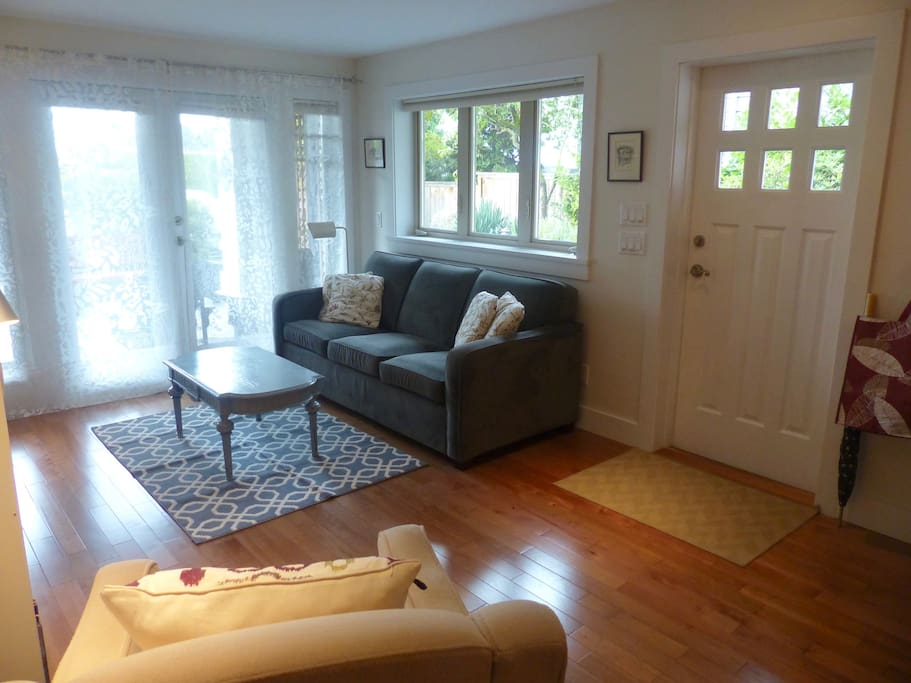 This ground floor suite is warm and inviting and has lots of light. French doors open to small patio.
