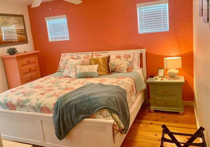 This room features a King Pillow Top bed with en-Master Suite bathroom that has a stand up shower